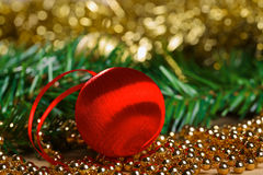 Red christmas ball with green fir-tree branch Stock Photos