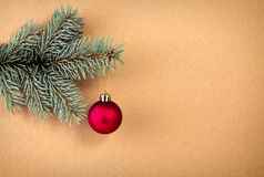 Red Christmas ball on green spruce branch  . Stock Image