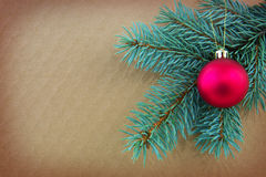 Red Christmas ball on green spruce branch isolated . Royalty Free Stock Photo