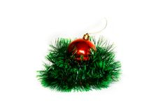 Red christmas ball and green tinsel Stock Photo