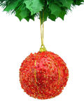 Red christmas ball isolated. Red christmas ball hanging from a green garland, isolated in white Stock Photography