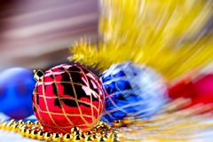 Red christmas ball with motion blurred christmas background Royalty Free Stock Image