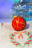 Red Christmas ball on a napkin Royalty Free Stock Image