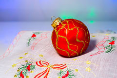 Red Christmas ball on a napkin Royalty Free Stock Images