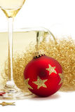Red christmas ball near glass with champagne, ange Royalty Free Stock Images