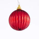 Red Christmas Ball Ornament. A red Christmas ball ornament isolated against a white background in the Square format Royalty Free Stock Photo
