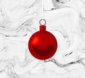 Red christmas ball ornament hanging on marble white background. Holiday concept, new year. stock images