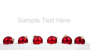Red Christmas ball ornaments/baubles on white stock image