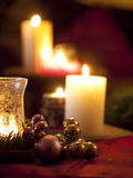 Red christmas ball ornaments with burning candles Royalty Free Stock Photo