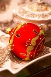 Red Christmas ball with ornaments - Christbaumschmuck. Luxury red Christmas ball with ornaments and pearls -Christbaumkugel Royalty Free Stock Images