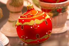 Red Christmas ball with ornaments - Christbaumschmuck. Luxury red Christmas ball with ornaments and pearls -Christbaumkugel Royalty Free Stock Image