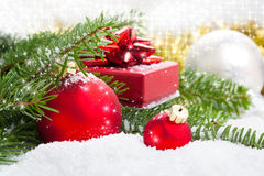Red Christmas ball with pine branch Stock Photography