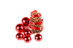 Red Christmas ball and pine cone with ribbon Stock Images