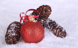 Red Christmas Ball and Pine Cones Stock Photos