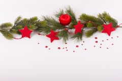 Red christmas ball and red stars on fir branch Stock Images