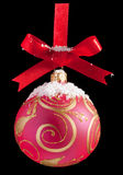 Red Christmas ball on a ribbon Royalty Free Stock Photo