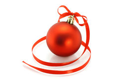 Red Christmas ball with ribbon Stock Image