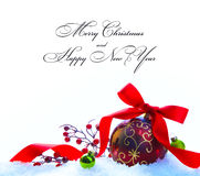 Red Christmas ball with ribbon and bow Royalty Free Stock Photos