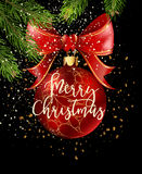 Red Christmas ball with ribbon and a bow Royalty Free Stock Photography