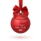 Red Christmas ball with ribbon and a bow. Red Christmas ball with ribbon and a bow, isolated on white background. Merry Christmas and Happy New Year 2017 Royalty Free Stock Photography