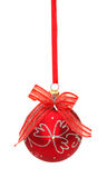 Red christmas ball with ribbon and bow on white Stock Photography