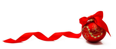 Red christmas ball with ribbon on a white background stock photos