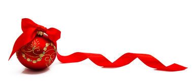 Red christmas ball with ribbon on a white background Stock Images