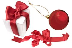 Red christmas ball, ribbon, white gift box Stock Image