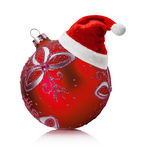 Red Christmas ball with Santa Claus hat isolated on the white ba Royalty Free Stock Photo