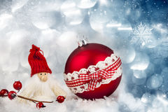 Red Christmas ball and Santa figurine Stock Photos