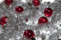 Red Christmas ball in Silver garland Royalty Free Stock Images