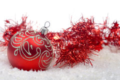 Red christmas ball with snow Royalty Free Stock Photo
