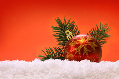 Red Christmas ball  and snow. Royalty Free Stock Photography