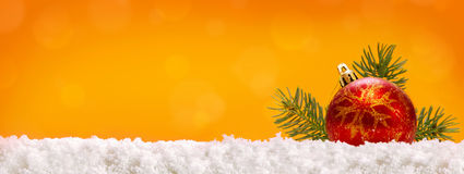 Red Christmas ball  and snow. Stock Image