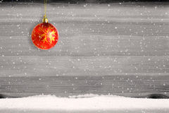 Red christmas ball and snow background. Royalty Free Stock Photography