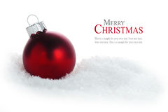 Red christmas ball in snow isolated on white background, sample Royalty Free Stock Photos