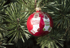 Red  Christmas Ball with socks and elks Royalty Free Stock Images