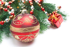 Red Christmas ball and spruce branches,  Royalty Free Stock Photography