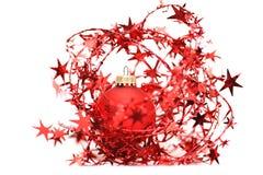 Red christmas ball among stars Royalty Free Stock Photo