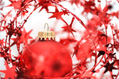 Red christmas ball among stars Royalty Free Stock Images