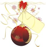 Red Christmas ball with sticker on the ribbon Royalty Free Stock Image