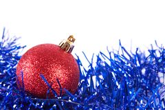 Red christmas ball with tinsel. On white Stock Photo