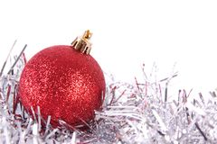 Red christmas ball with tinsel Royalty Free Stock Image