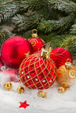 Red christmas ball under evergreen tree Royalty Free Stock Photography
