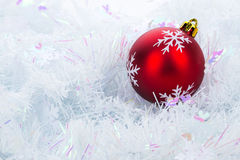 Red christmas ball on white brunch background. Single red christmas ball on white brunch background in a soft atmosphere Royalty Free Stock Photo