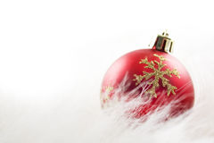 Red Christmas ball on white fur Royalty Free Stock Photos