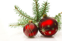 Red  christmas balls. With a green fir branch isolated on a white background Stock Images