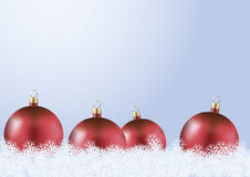 Red christmas balls. With snow on blue background Stock Images