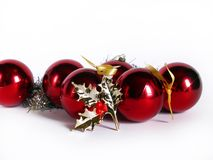 Red christmas balls. Christmas ornaments over white;balls and holy leaf Stock Images