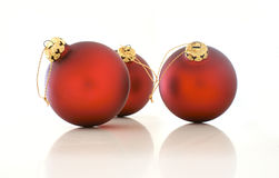 Red Christmas balls. Three red Christmas balls on a white background Stock Photography